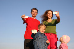 Family with cards for text Royalty Free Stock Photography