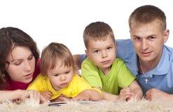 Family on carpet Stock Photo