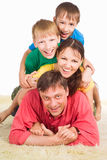 Family on carpet Stock Image