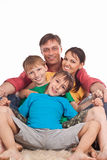 Family on carpet Royalty Free Stock Photo