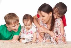 Family at carpet Stock Image