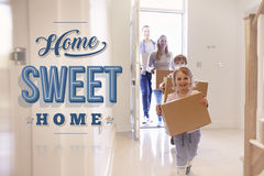 Family Carrying Boxes Into New Home Sweet Home stock images
