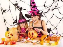 Family carving pumpkin. Mother and daughter on Halloween party with  carved pumpkin Stock Photography