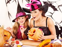 Family carving pumpkin . Mother and daughter on Halloween party with  carved pumpkin Royalty Free Stock Photo