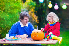 Family carving pumpkin at Halloween Royalty Free Stock Photos