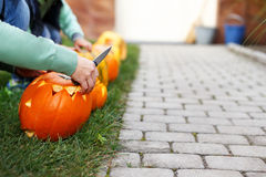 Family carving pumpkins in preschool Stock Image
