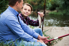 Family with catched fish Stock Image