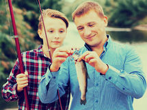 Family with catched fish Royalty Free Stock Photos