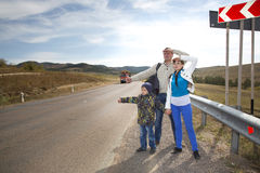 Family catches the car Royalty Free Stock Images