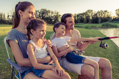Family catching fish Royalty Free Stock Photos