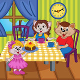 Family cats eat cake together Royalty Free Stock Photo