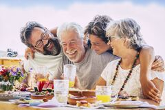Free Family Caucasian People Hug And Enjoy Celebration Together - Mixed Ages With Teeanger, Adult And Senior People Having Lunch And Royalty Free Stock Images - 192282969