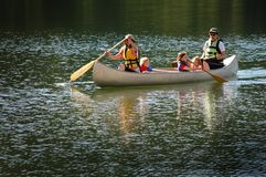 Family Canoeing Together On Lake in Wilderness royalty free stock photos