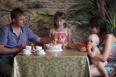 Family celebrate birthday of daughter Royalty Free Stock Photos