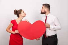 Family celebrate valentine`s day, sending each other air kiss Stock Photography