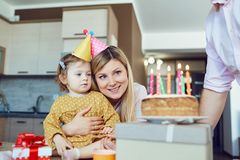 Family celebrates birthday with a birthday cake. royalty free stock image