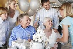 Family Celebrating 25Th Anniversary. Happy family celebrating 25th anniversary of parents Royalty Free Stock Image