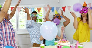 Family celebrating birthday. Cheerful family celebrating birthday at home stock video footage