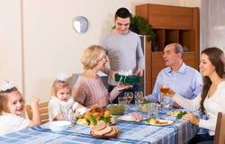 Family celebrating birthday at festive dinner Stock Image