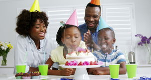 Family celebrating birthday. Girl blowing out birthday candles stock footage