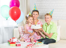 Family celebrating a birthday at home Royalty Free Stock Image