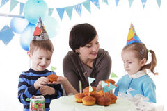 Family celebrating birthday party with cakes Stock Image