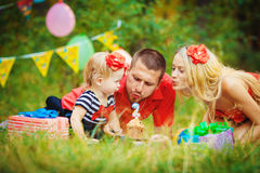Family celebrating birthday party in green park outdoors Stock Photo