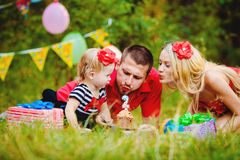 Family celebrating birthday party in green park outdoors Royalty Free Stock Images