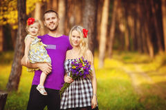 Family celebrating birthday party in green park outdoors Royalty Free Stock Photo