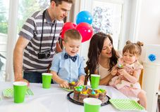 Family Celebrating Birthday Party At Home. Family and children celebrating birthday party at home Stock Image