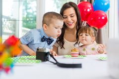 Family Celebrating Boy's Birthday Stock Photos