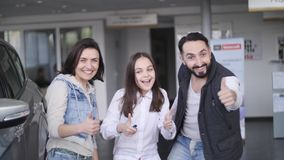 Family celebrating buying a new car.  stock footage