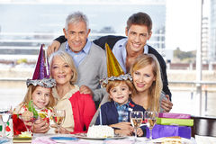 Family celebrating child birthday Royalty Free Stock Photos