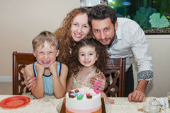 Family celebrating child's birthday Stock Image