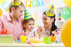 Family celebrating child's birthday Stock Photo