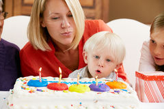 Family Celebrating Children's Birthday Stock Photos