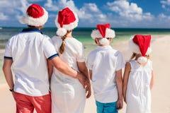 Family celebrating Christmas at beach Stock Image