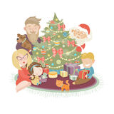Family celebrating Christmas at the christmas tree Stock Image