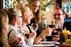 Family celebrating Christmas dinner Royalty Free Stock Images
