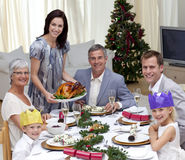 Family celebrating Christmas dinner with turkey. At home stock photo