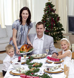 Family celebrating Christmas dinner with turkey Royalty Free Stock Images