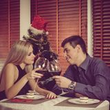 Family celebrating Christmas. Excited happy husband and wife clinking and celebrating Christmas Stock Photography