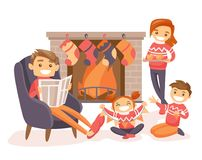 Family celebrating Christmas by the fireplace. Royalty Free Stock Images