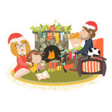 Family celebrating Christmas at fireplace Stock Images