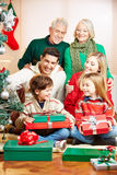 Family celebrating christmas with gifts Royalty Free Stock Images