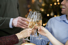 A family celebrating Christmas with a glass of champagne Stock Photography