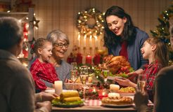 Family celebrating Christmas. Merry Christmas! Happy family are having dinner at home. Celebration holiday and togetherness near tree stock images
