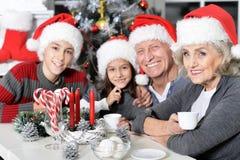 Family celebrating Christmas Stock Photography