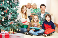 Family celebrating christmas with three generations Stock Photo