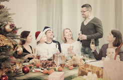 Family Celebrating Christmas together Stock Images